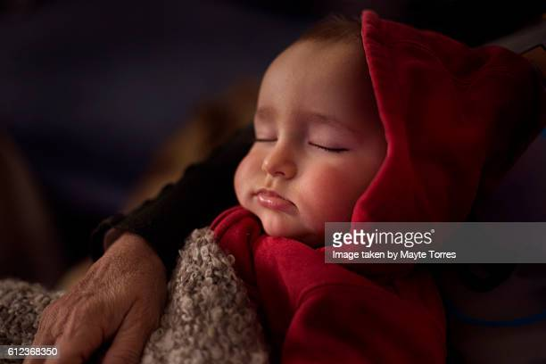 toddler nap with red hoodie