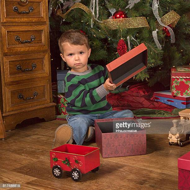 Toddler opens up an empty Christmas Gify
