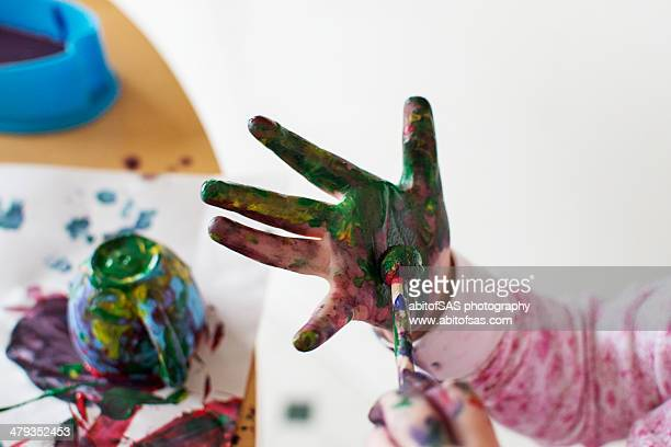 Toddler painting hand