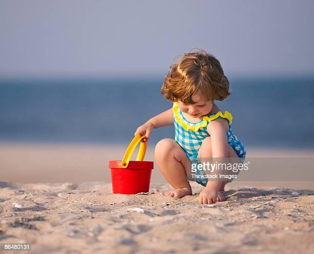 Toddler playing at beach