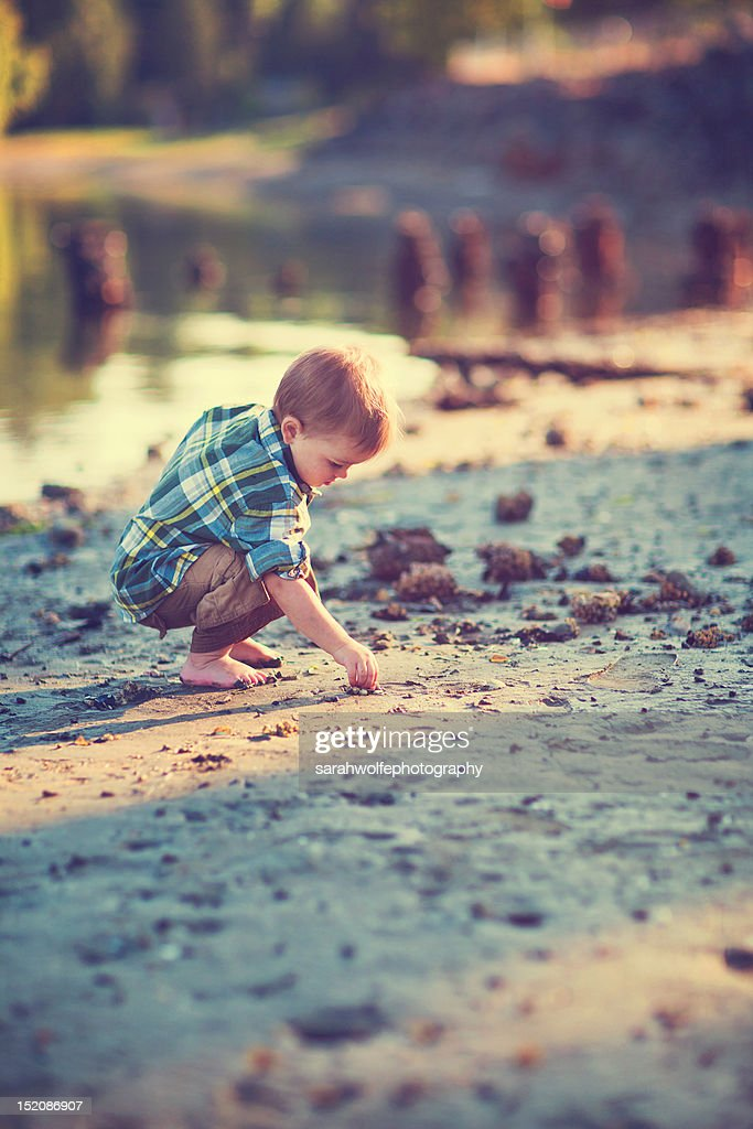 Toddler playing in sand : Stock Photo