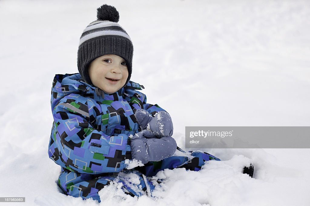 Toddler playing in snow : Stock Photo