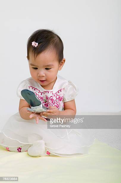 Toddler playing with cell phone