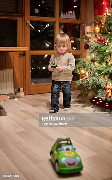 Toddler playing with his new Toy Car on Christmas