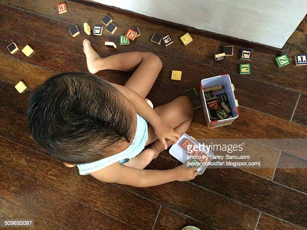 Toddler playing with letters