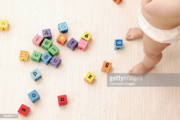 Toddler playing with toy blocks