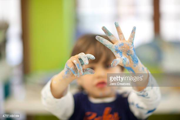Toddler playing with watercolour in class