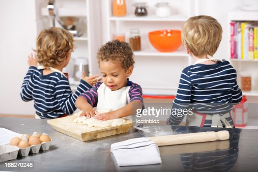 Toddler Preparing Dough While Peers Look For More ...
