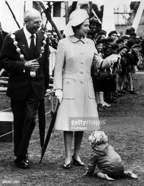 A toddler provides an amusing interlude for the Queen duing her visit to Timaru New Zealand