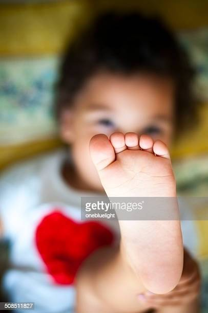 PEOPLE: Toddler (2-3) Putting Her Feet Up.