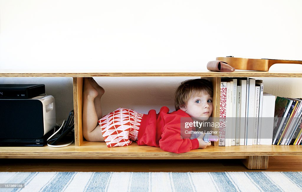 Toddler relaxing in cubby : Stock Photo