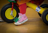 A toddler rides a bike at a playgroup for preschool aged children in Chilcompton near Radstock on January 6 2015 in Somerset England Along with the...
