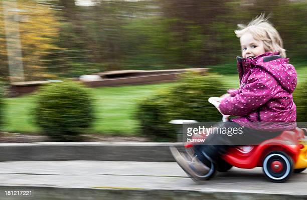 Toddler riding Bobbycar