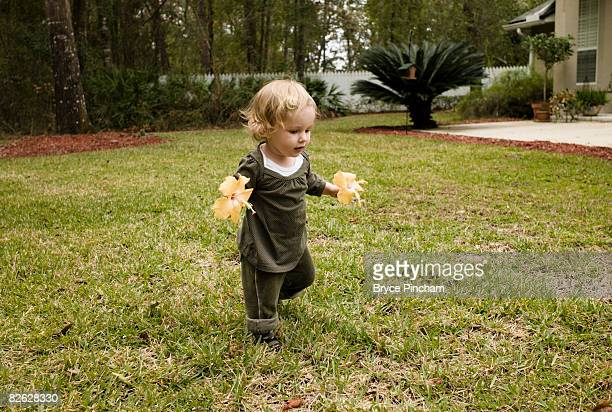 toddler running with flowers