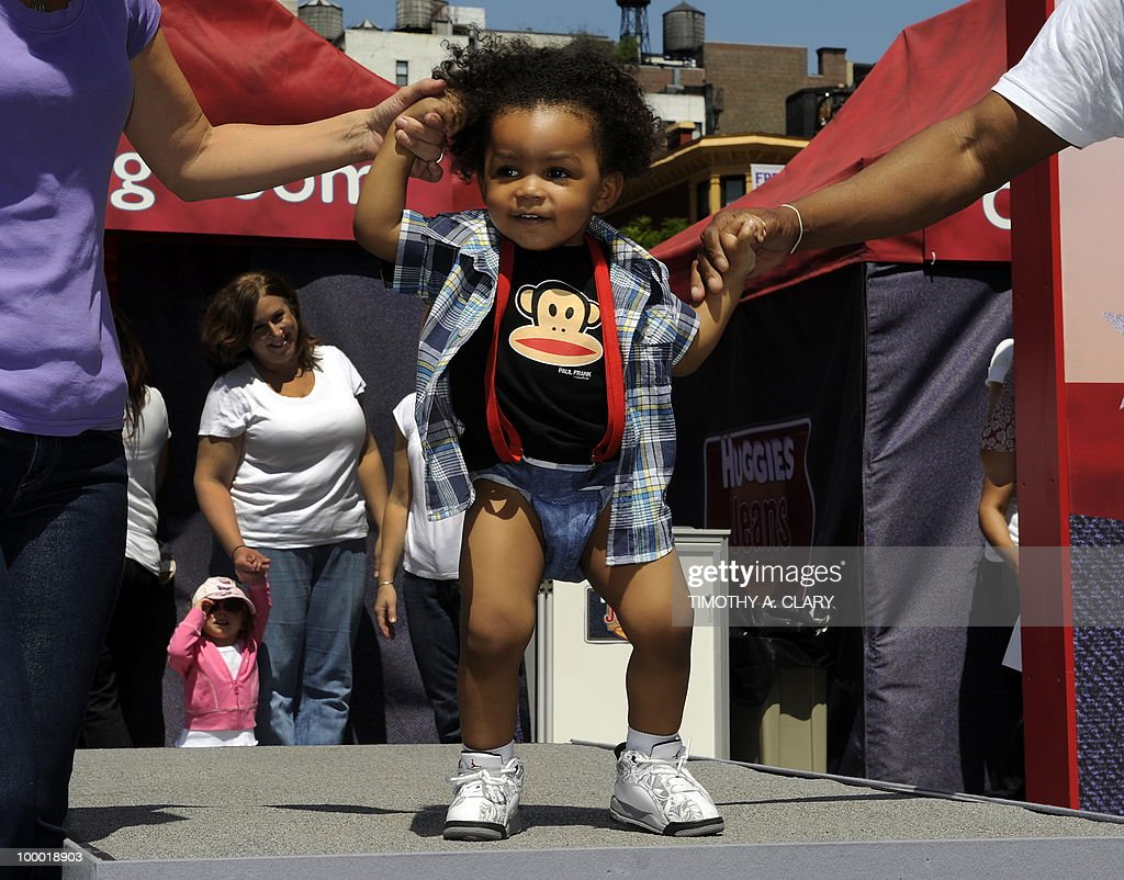 A toddler shows off his new Huggies Little Movers Jeans Diapers during the 'What's Your Denim Style' baby fashion show in Union Square May 20, 2010. The all-new jeans design by Huggies are the new look for summer.