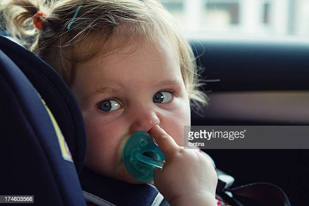 toddler sit in her car seat during the travel