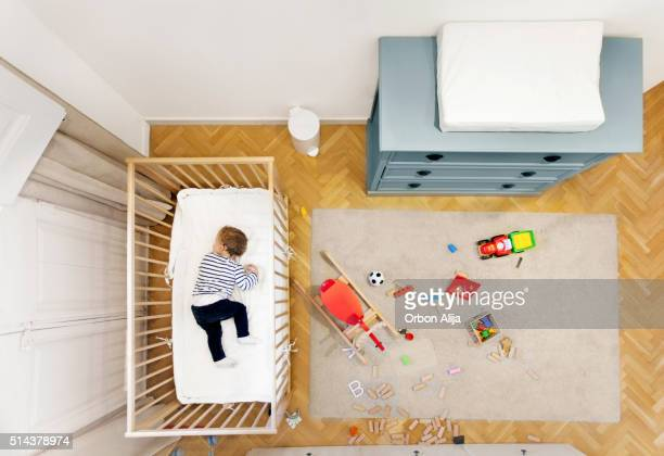 Toddler sleeping in his room