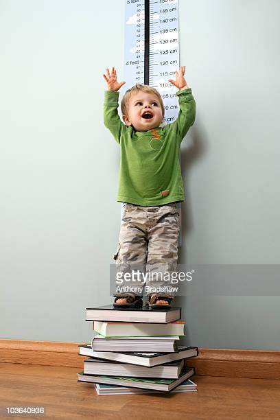 Toddler stretching to full height