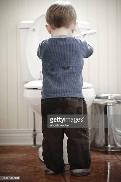 Toddler takes on toilet