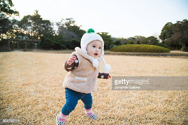 Toddler taking her first steps