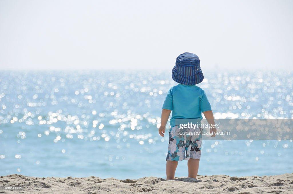 Toddler walking on beach : Stock Photo