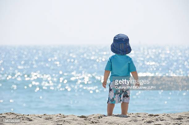 Toddler walking on beach