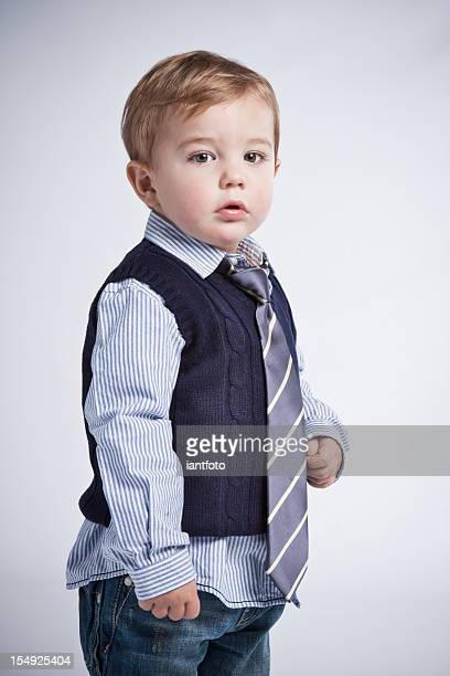 Toddler wearing a shirt and tie