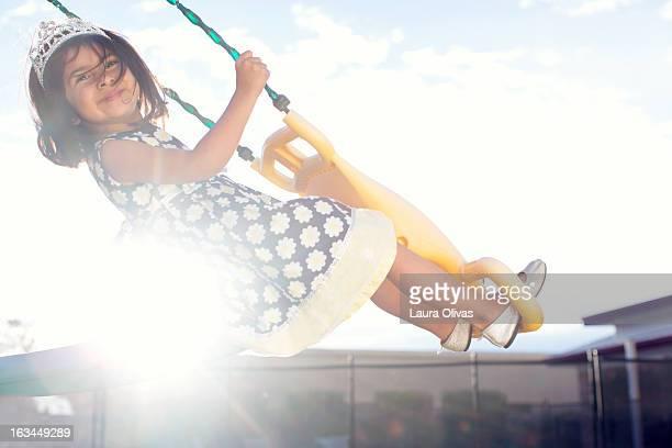 Toddler Wearing Tiara on Swing