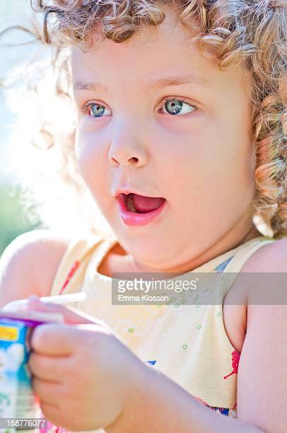 Toddler with Juice Box