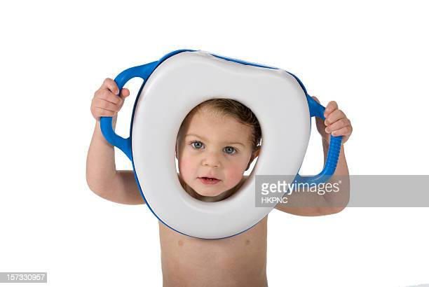 Toddler with potty training toilet ring around face