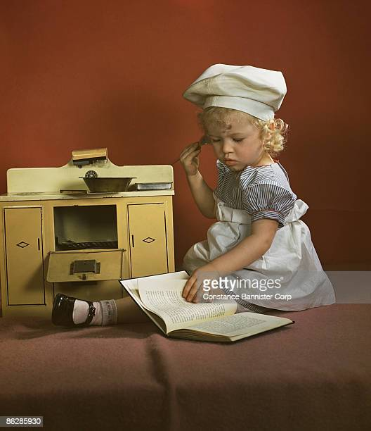 Toddler with toy oven