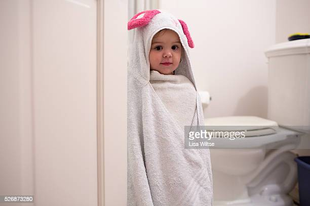 Toddler wrapped in a towel