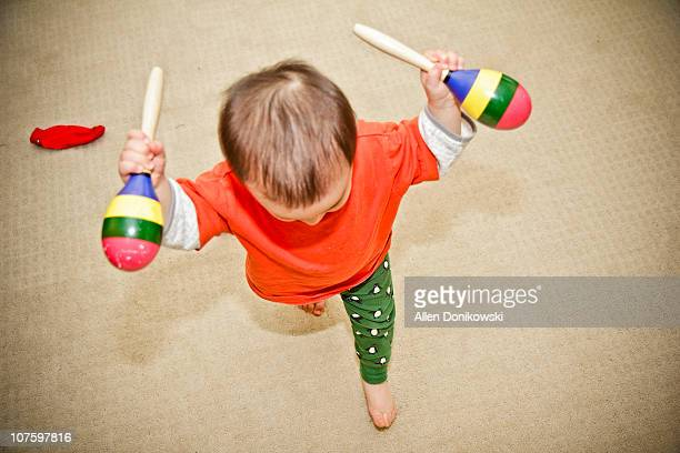 Toddler_in_motion_running_with_maracas