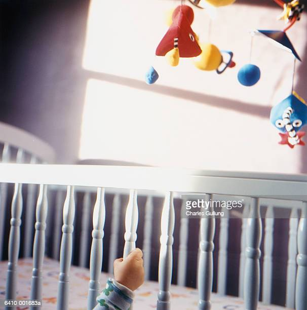 Toddler's Hand on Crib