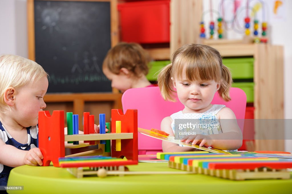 Toddlers Interacting During Playtime In A Nursery Setting