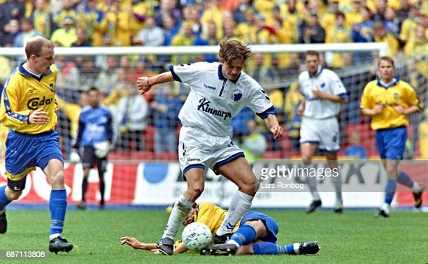 Todi Jonsson of FC Copenhagen and Allan Ravn of Brondby IF compete for the ball during the Danish Cup Final Compaq Cup match between FC Copenhagen...