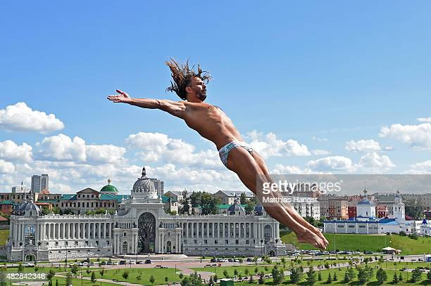 Todor Spasov of Bulgaria competes in the Men's High Diving 27m preliminary round on day ten of the 16th FINA World Championships at the Kazanka River...