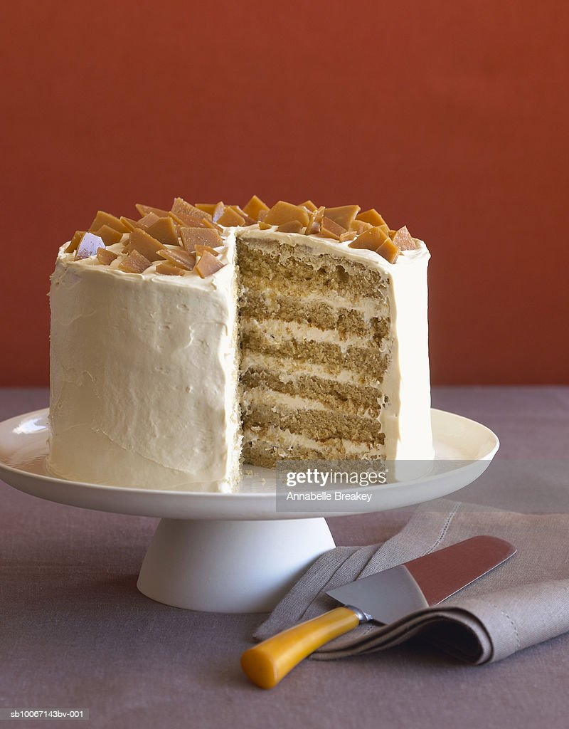 Toffee cake with slice missing : Stock Photo