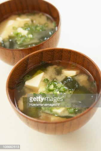 Tofu and seaweed in Miso soup, close up, white background : Stock Photo