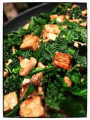 Healthy cooking tofu mushroom kale stir fry. Shot/processed on mobile device.