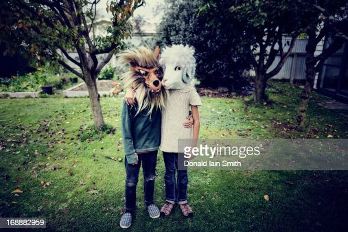 Togetherness: wolf and sheep : Stock Photo