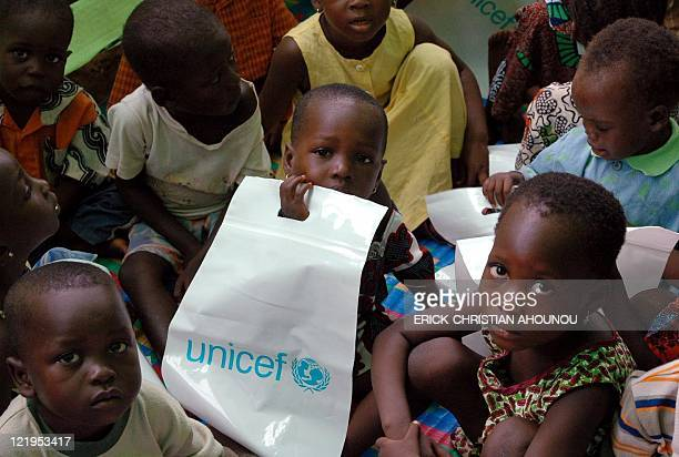 Togolese children pose for photographers prior to attend their first day of class at the UNICEF refugee camp of Aganm 120 kms from Cotonou Benin 30...