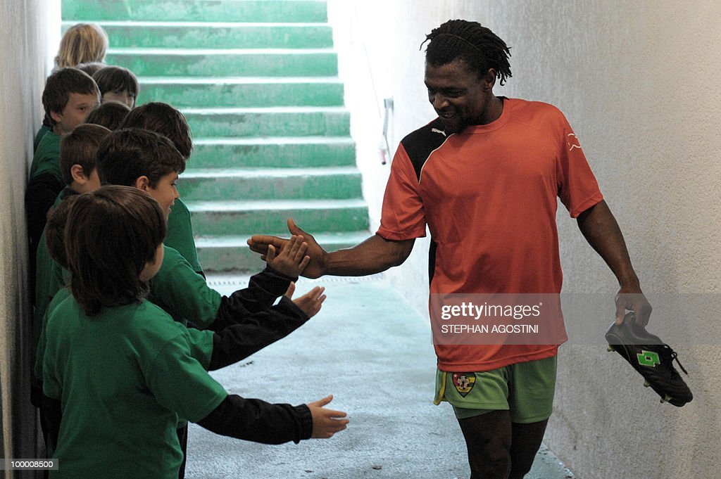 PERAUT - Togolese football national team player Thomas Dossevi salutes youngsters prior to a friendly match against Gabon as part of the 'Corsica football Cup' on May 19, 2010 at the François Coty Stadium in Ajaccio.