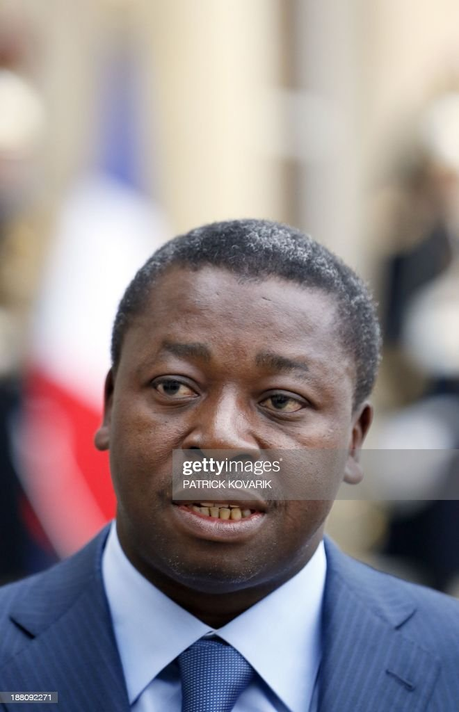 Togolese President Faure Gnassingbe (L) speaks to jounralists after a meeting with the French president at the Elysee Palace in Paris on November 15, 2013.