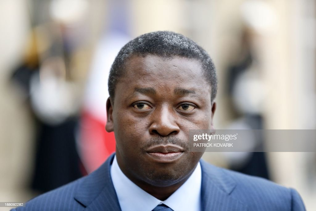 Togolese President Faure Gnassingbe (L) speaks to jounralists after a meeting with the French president at the Elysee Palace in Paris on November 15, 2013. AFP PHOTO / PATRICK KOVARIK