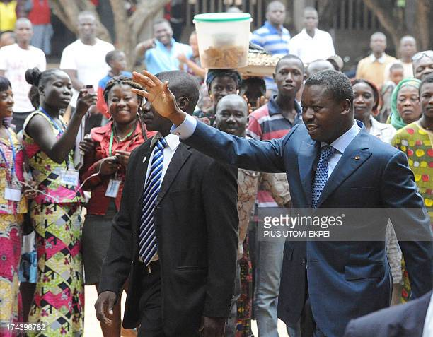 Togolese President Faure Gnassingbe waves to the crowd as he arrives to cast his vote during the parliamentary election in Lome on July 25 2013...