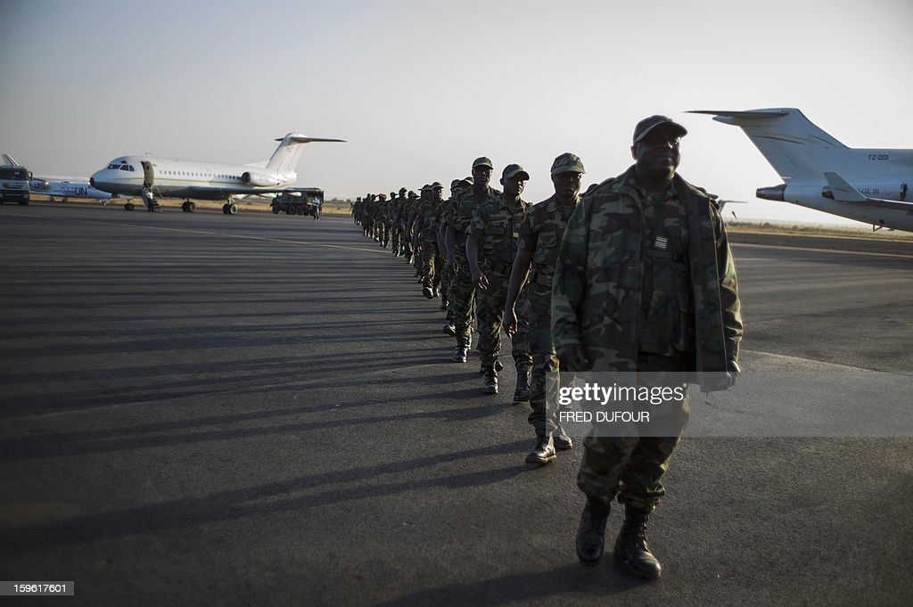 Togolese soldiers arrive at the airport on January 17, 2013, in Bamako. Forty Togolese soldiers arrived in Mali today, the first of those pledged by African nations to back a French-led offensive against Islamist rebels. West African troops have promised more than 3,000 soldiers to back Operation Serval, launched on January 11.