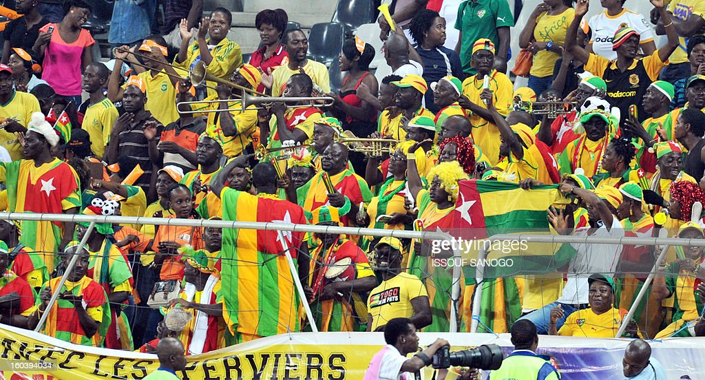Togolese supporters cheer during the Africa Cup of Nations 2013 group D football match Togo vs Tunisia on January 30, 2013 at the Mbombela stadium in Nelspruit. Togo drew 1-1 with Tunisia today to complete the Africa Cup of Nations quarter-final cast list and send the Carthage Eagles heading back to Tunis.