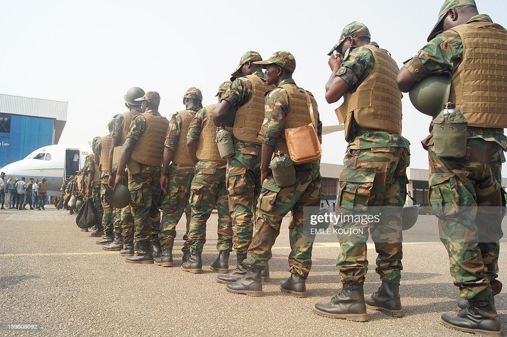 Togolese troops board a plane to Bamako on January 17, 2013 at the Lome airport. The first contingent of a planned 500 Togolese troops due to be deployed in Mali as part of an African force departed from Lome, today, an AFP journalist reported. 'Around 100 are leaving Lome today for Mali,' army spokesman Colonel Djibril Inoussa told AFP earlier. 'Another wave will follow in the coming days.' More French troops also poured into Mali on Thursday, boosting their number to 1,400, the defence minister said. At full strength the force will be made-up of 2,500 soldiers. AFP PHOTO EMILE KOUTON