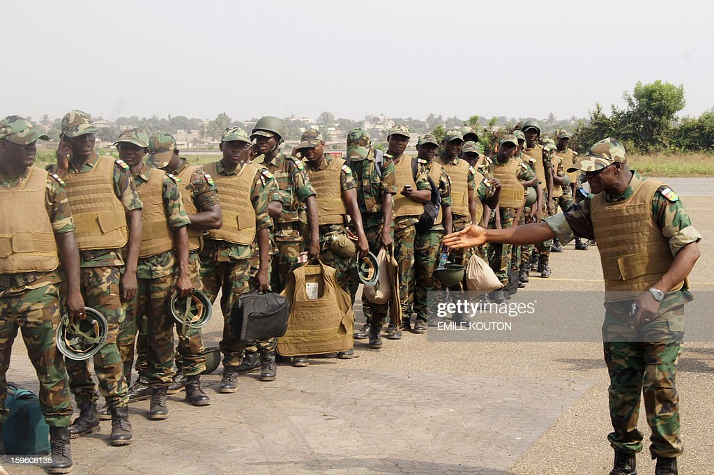 Togolese troops board a plane to Bamako on January 17, 2013 at the Lome airport. The first contingent of a planned 500 Togolese troops due to be deployed in Mali as part of an African force departed from Lome, today, an AFP journalist reported. 'Around 100 are leaving Lome today for Mali,' army spokesman Colonel Djibril Inoussa told AFP earlier. 'Another wave will follow in the coming days.' More French troops also poured into Mali on Thursday, boosting their number to 1,400, the defence minister said. At full strength the force will be made-up of 2,500 soldiers.